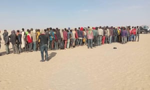 Migrants who were dumped in the desert near the Libyan border.