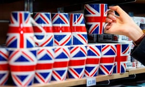"""A woman looks at merchandise for sale in a souvenir shop on Whitehall in London on October 22, 2017. Britain could be left """"poorer and weaker"""" by Brexit and needing to spend more to maintain influence abroad, the former head of the country's foreign intelligence agency warned earlier this week. / AFP PHOTO / Tolga AKMENTOLGA AKMEN/AFP/Getty Images"""