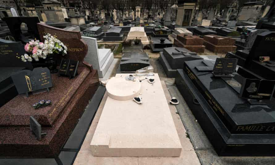 The vandalised grave of US artist Man Ray.