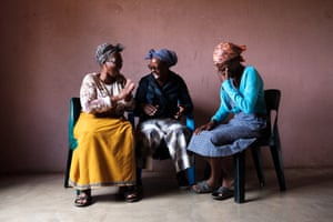Minky sits and laughs with her friends and fellow HIV support group members Jabu Shongwe, 52 (left), and Bonsile Nkuna, 37 (centre). While anti-retrovirals are readily available from the government, theirs is an environment where resources for those affected by HIV and their families are very limited, and the informal group is an important support structure for both those who are HIV-positive and their carers. Members provide education on living healthily with HIV and managing the challenges of anti-retroviral therapy (ART). Members also cook and clean for those too ill to do it themselves