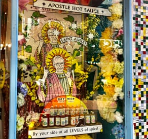 A 'shrine' to Ashley Bloomfield doubles as an advertisement for hot sauce in a gift shop window in Wellington.
