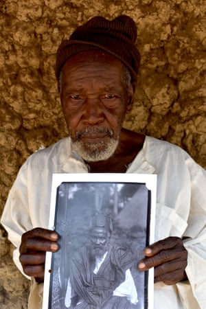Pa Amadu Kamara with N. W. Thomas's photograph of his grandfather, Satimaka Memneh, taken in 1914, Mamaka, Northern Province, Sierra Leone