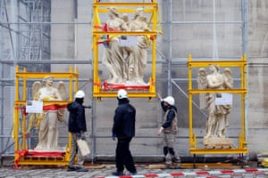 Paris, France Sculptures in transport cages are seen waiting for installation on the dome of the Val-de-Grace church .