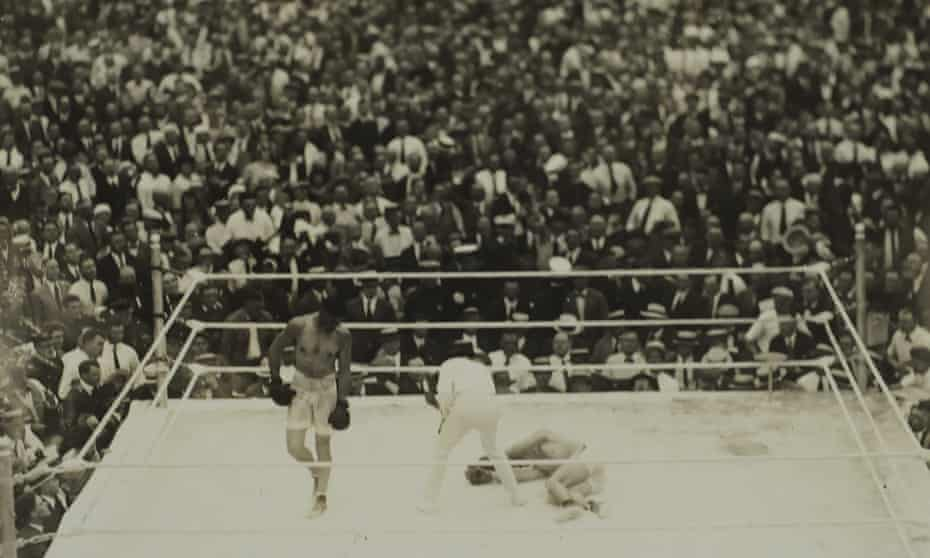 Jack Dempsey waits as the referee counts out Georges Carpentier.
