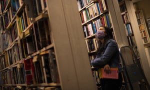 A woman browses in a Brussels bookshop
