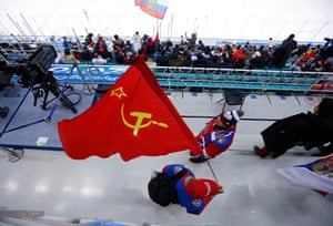 Fans waving a Soviet Union flag before the OAR clash with the USA in the men's ice hockey
