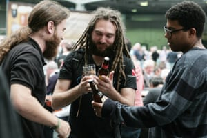 Dreadlocks and bottle tops: comparing the merits of different drinks.