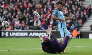 Southampton's goalkeeper, Fraser Forster, clashes with Manchester City's Sergio Agüero