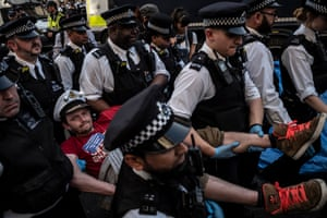 Another activist is removed by police at Oxford Circus on Good Friday