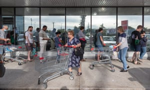 Shoppers are seen queuing at Coles Maylands in Perth