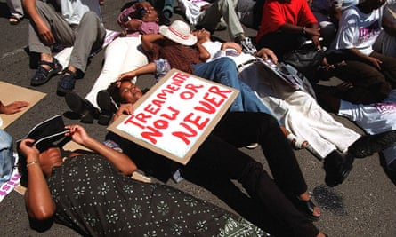 Aids activists stage a 'die-in' outside parliament in Cape Town in 2001 during a protest to demand that the government and pharmaceutical companies allow the importation of generic medicines for the treatment of HIV/Aids.