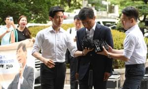 Ahn Hee-jung outside court.