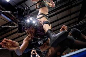 Aria Palmer (top) kicks Scott through the ropes during Autumn Armageddon 2018 in Galena, Maryland.