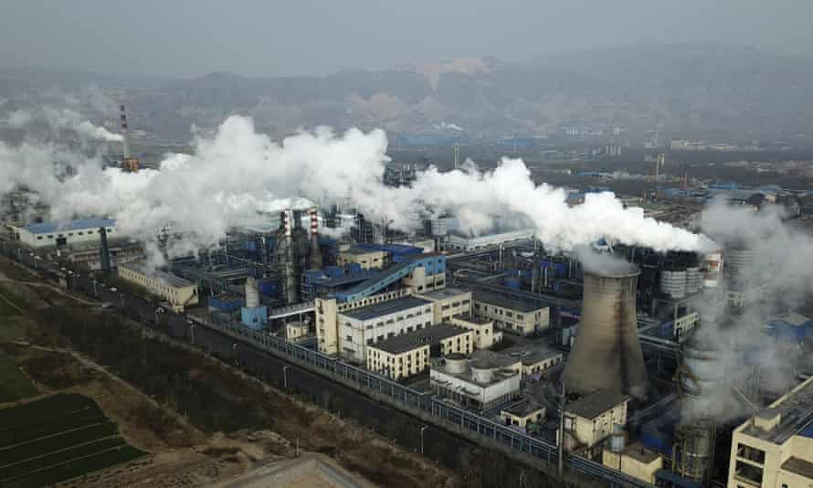 Smoke and steam rise from a coal processing plant in Hejin in central China's Shanxi Province