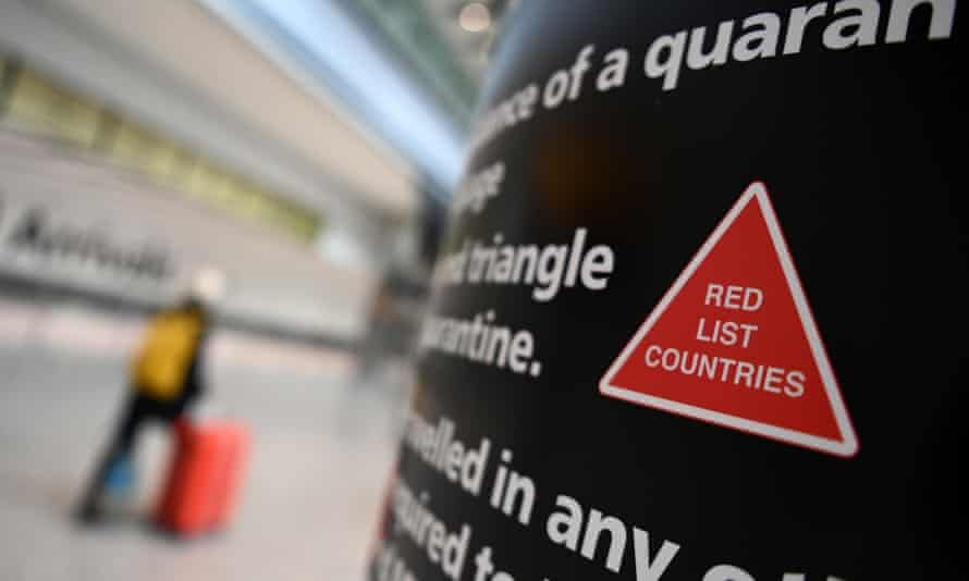 Red list travel sign in an airport