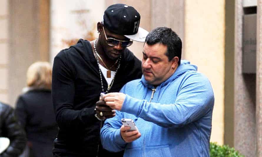 Mino Raiola (right), pictured with Mario Balotelli in Milan in 2013
