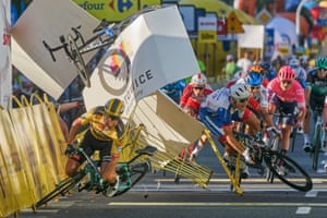 The Dutch cyclist Dylan Groenewegen (left), crashes metres before the finish line after colliding with his compatriot Fabio Jakobsen