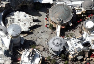 Crowds walk near the Millennium Falcon spaceship inside Star Wars: Galaxy's Edge at Disney's Hollywood Studios, before it shut down