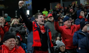 Munster fans celebrate during the European Champions Cup match against Exeter at Thomond Park.
