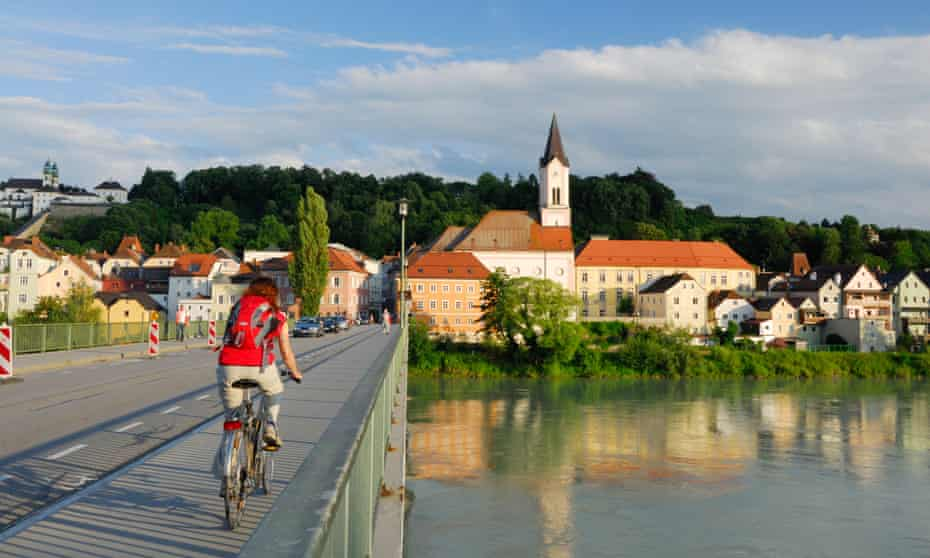 Cycling over the River Inn on the Danube Cycle Route in Passau, Lower Bavaria.