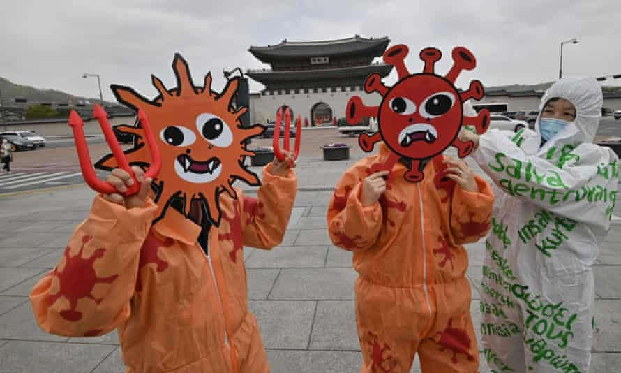 Covid-19 masks at an Earth Day event in Seoul, South Korea, linking ecosystem destruction to the root causes of the coronavirus pandemic.