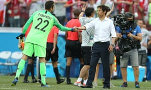 Lukasz Fabianski, Poland's goalkeeper, shows there are no hard feelings as he shakes hands with Akira Nishino.