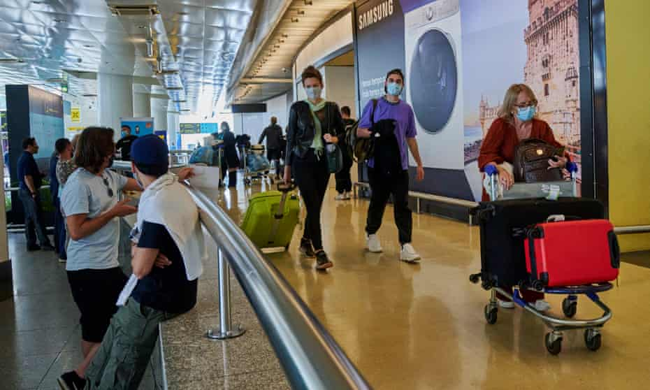 An arrivals area at Humberto Delgado international airport in Lisbon, Portugal, on 17 May.