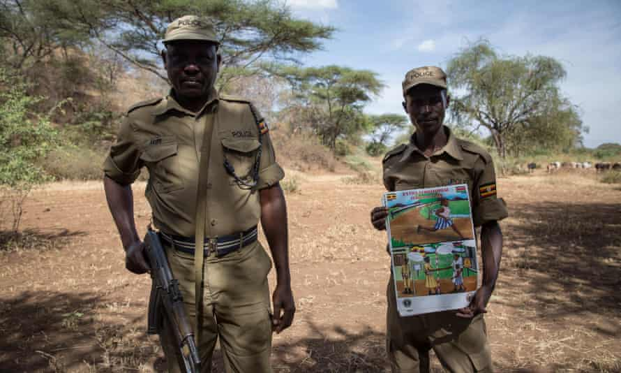 Ugandan police display a poster warning girls not to cross the border to Kenya to undergo female genital mutilation