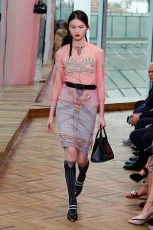 A crystal-embellished pink shirt, layered-up skirt and requisite pigtails.
