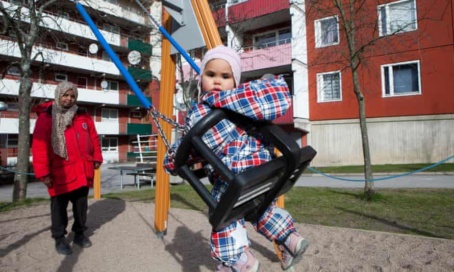 A  Somalian girl   in a playground  in the Husby neighbourhood of Stockholm,