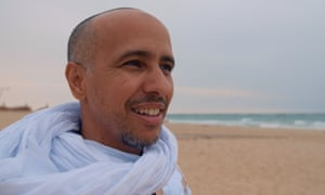 Mohamedou Ould Salahi on Nouakchott beach a few days after his release from Guantánamo Photograph: Laurence Topham/The Hlcarpenter.com