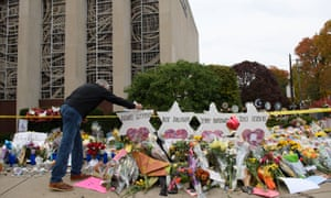 Mourners visit the memorial outside the Tree of Life Synagogue on 31 October 2018 in Pittsburgh, Pennsylvania.