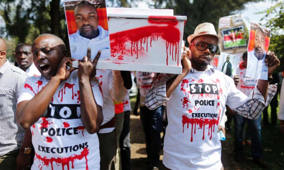 Kenyan activists carry a portrait of murdered taxi driver Joseph Muiruri, who was killed along with lawyer, Willie Kimani, and his client, Josephat Mwenda, Nairobi, Kenya, July 2016