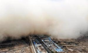 Zhangye, China:A sandstorm engulfs the village.