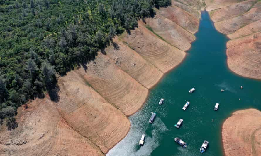Houseboats are dwarfed by the steep banks of Lake Oroville last month in Oroville, California.