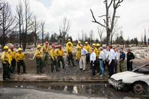 29 June: 'The president views fire damage with firefighters and elected officials in Colorado Springs after devastating wildfires swept through the region the week before'