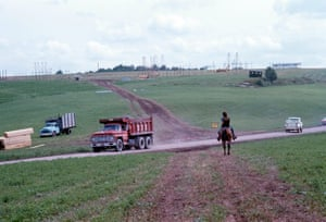 """Early Days at Bethel with transportation. © Henry Diltz Michael Lang """"In the early days of construction at Bethel there was so much rain during the early preparation that I started getting around on a horse instead of being buried in mud on my motorcycle""""."""