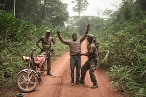 The rangers of the dog squad search a motorcycle taxi for pangolin scales or hunting ammunition in the Dzanga-Sangha park, Bayanga, Central African Republic