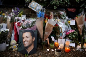Tributes left outside George Michael's London home after the pop star died at the age of 53 from suspected heart failure