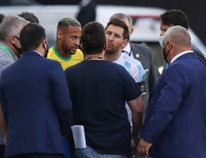 Argentina's Lionel Messi and Brazil's Neymar are seen as play is interrupted.