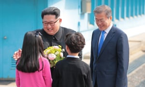 North Korean leader Kim Jong-un and South Korean President Moon Jae-in with children presenting flowers to Kim.