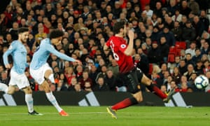 Leroy Sane fires home Manchester City's second goal against Manchester United at Old Trafford.
