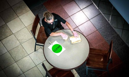A woman sits at a table with a sign reading 'clean' at the Mall of America in Bloomington, Minnesota.