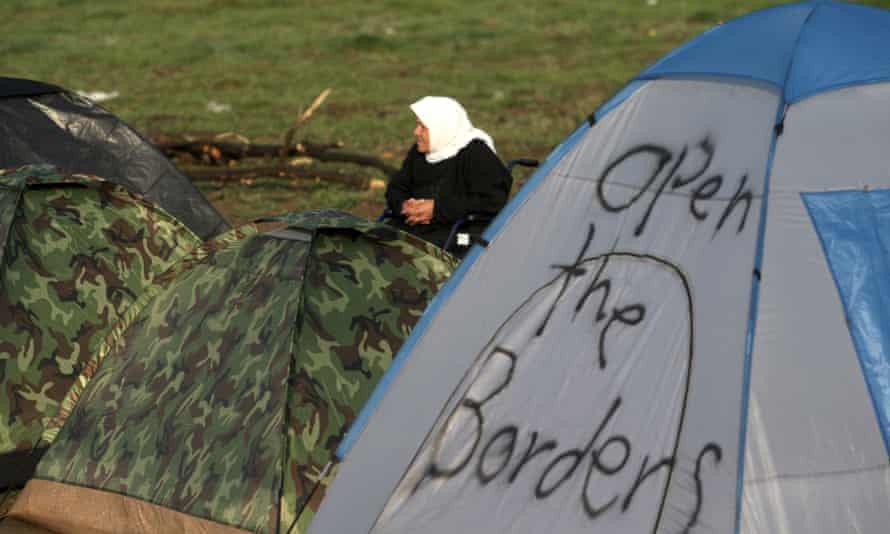 A woman sits in a tent camp near Idomeni on 1 March, 2016 at the Greek-Macedonian border.