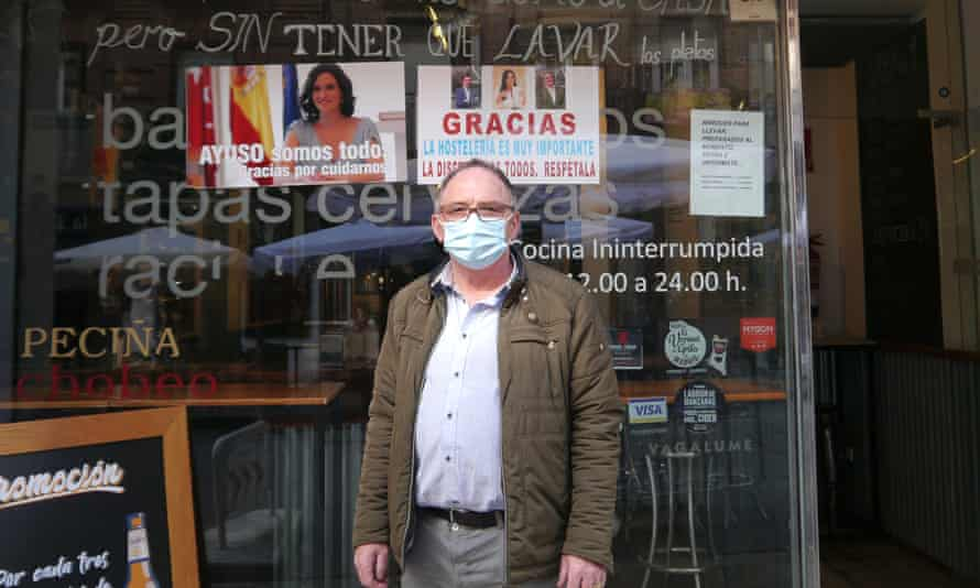Madrid bar owner José Nieto with posters in support of Ayuso.