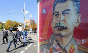 People walk past a portrait of Soviet dictator Joseph Stalin in the centre of Donetsk, the main city held by pro-Russian rebels in eastern Ukraine.