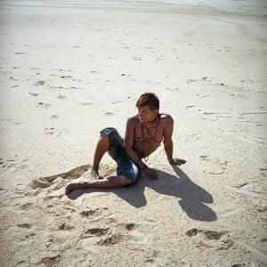 Munduruku tribal member rests on a sandbar during a protest