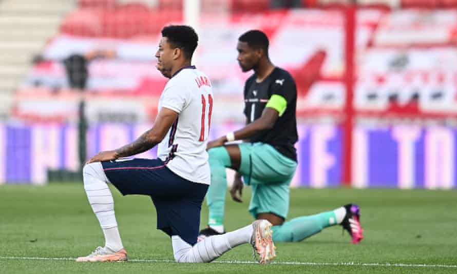 Jesse Lingard of England and David Alaba of Austria take a knee in Middlesbrough.
