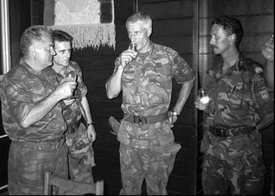 General Ratko Mladić of the Bosnian Serb army, left, drinks with Dutch colonel Ton Karremans, second right, in the Bosnian village of Potocari, on 12 July 1995.