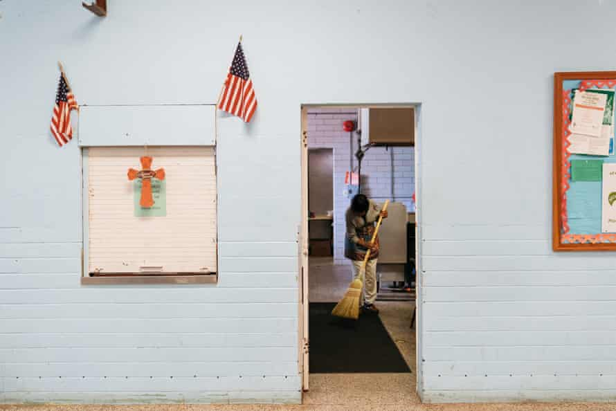 Mary Quick sweeps after the Holy ghost Community Meal in Opelousas, Louisiana.